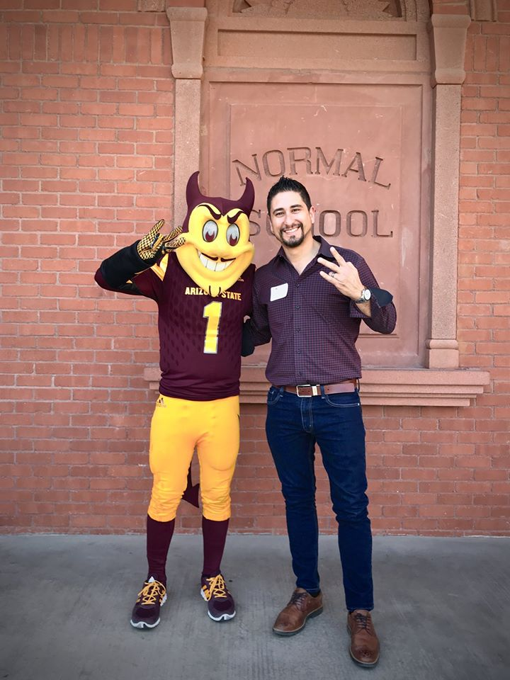 Rami posing with Sparky after the ASU Sun Devil 100 Award Ceremony.
