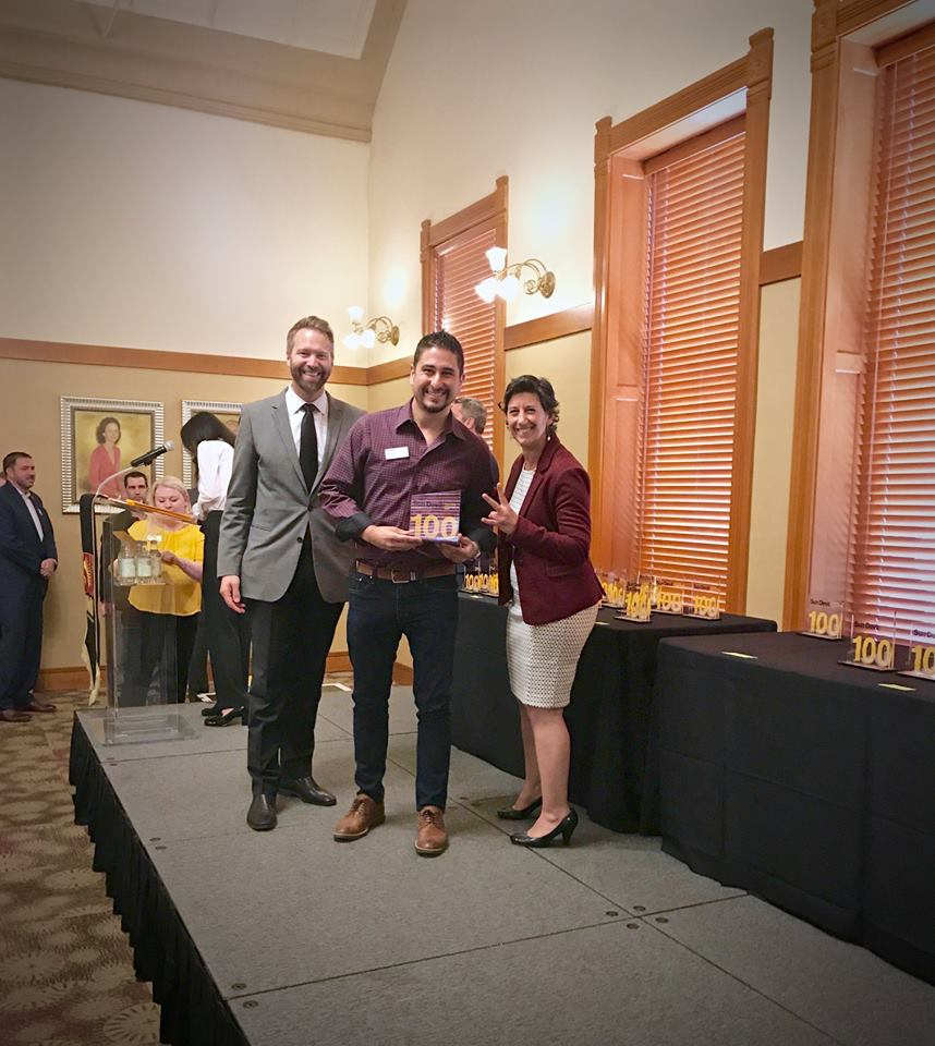 Rami accepting his ASU Sun Devil 100 Award.